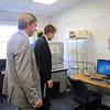 Congressman Kennedy and Secretary of Housing & Economic Development Greg Bialecki look on as Professor Marina Bogard demonstrates how MassBay's new 3D scanner works.