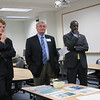 President O'Donnell, flanked by Congressman Kennedy and Newton Mayor Setti Warren, listens to STEM faculty presentations.