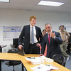 Secretary Malone makes a point as Congressman Kennedy looks on during his visit to MassBay's STEM Division laboratories.