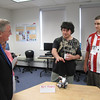 Nick Dieher, 19, of Natick and Ben Cartier, 18, of Natick explain their robotics projects to MassBay President John O'Donnell and Professor of of Computer Science Shamsi Moussavi as part of MassBay's Summer Bridge program.