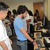 Timothy Chong, 18, Newton, reviews the computer project created by Gilad Cohen, 18, Newton,as part of MassBay's Summer Bridge program.