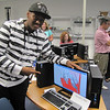 Mat Houston, 18, of West Newton shows off the frame-by-frame Flash animation he created over the course of five days as part of MassBay's Summer Bridge Program.