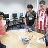 MassBay President John O'Donnell and Professor of of Computer Science Shamsi Moussavi review the robotics projects presented by (From left) Nick Dieher, 19, of Natick; Ben Cartier, 18, of Natick; and Neha Jain, 19, of Westborough as part of MassBay's Summer Bridge program.