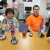 From left: Nick Dienel, 19, of Natick and Ben Cartier, 19, of Natick pose with the Soccer Bots that they built and programmed together. The small robots are able to sense, follow, and even kick a ball moving in front of them.