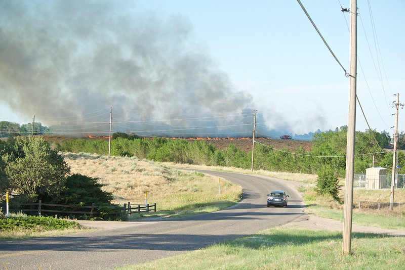 A grass fire sparked Tuesday evening in the Country Club Hills neighborhood near the Northeastern 18 Golf Course west of Sterling. Mack Hitch took this photo from Pawnee Drive, southeast of the golf course. (Photo courtesy of Mack Hitch)