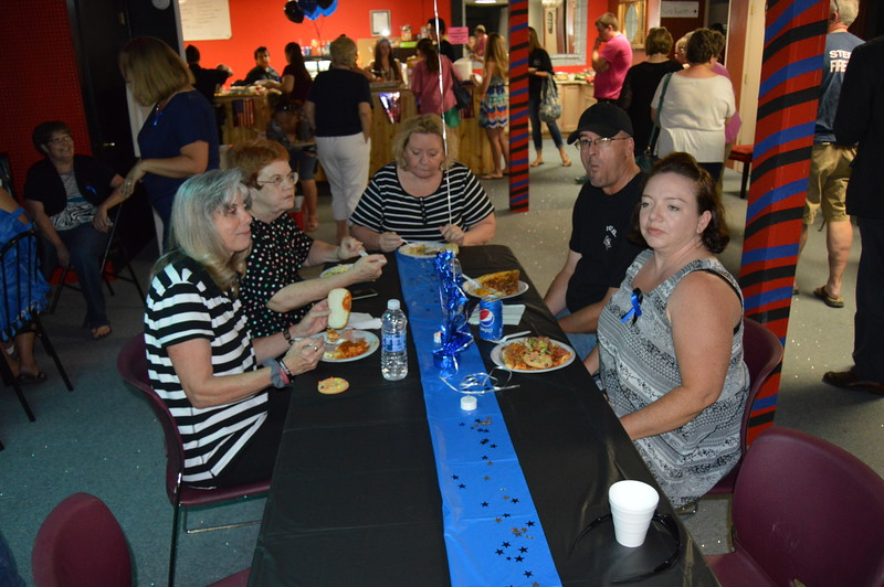 From left: Shari Bollish, Lila Koch, Virgie Nelson, Clay Bradshaw and Denise Bradshaw enjoy the meal at the law enforcement appreciation event.