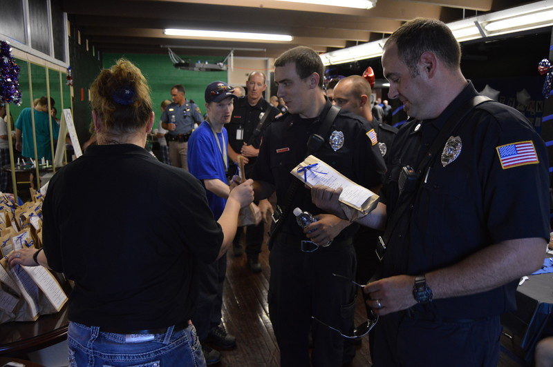 "Each member of local law enforcement and first responder agencies received a gift bag labeled as a ""Survival Kit"" featuring various types of candy."
