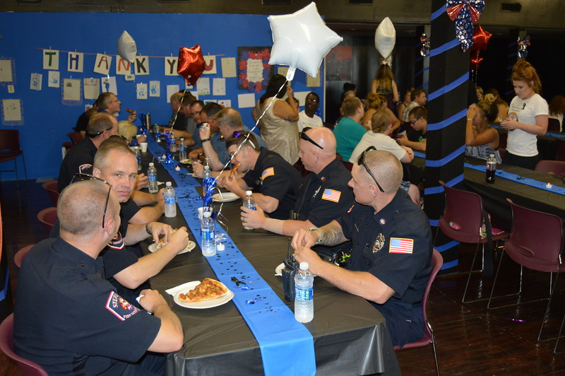 Sterling fire and police personnel enjoy the meal with the community.