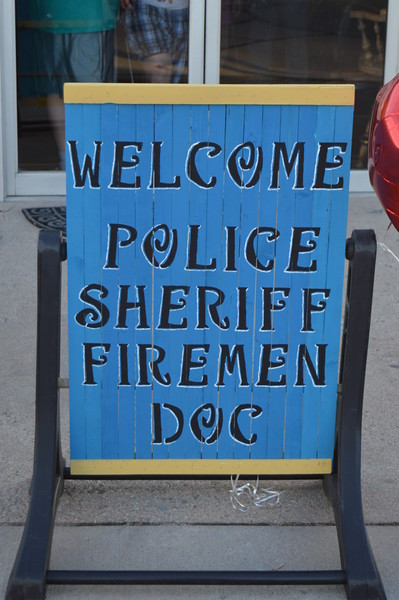 A sign welcomes various agencies that make up the public safety community to an appreciation event Thursday, July 21, 2016, at Two Roses.