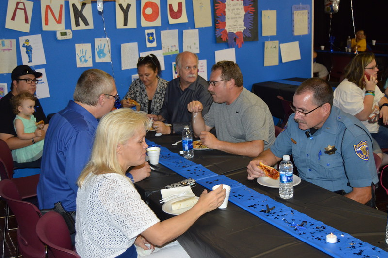 Sterling law enforcement personnel enjoy the meal with the community.