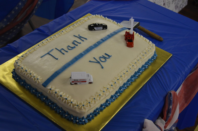 "A cake featuring a thin blue line, toy emergency response vehicles and the words ""Thank You"" was served at the appreciation dinner."