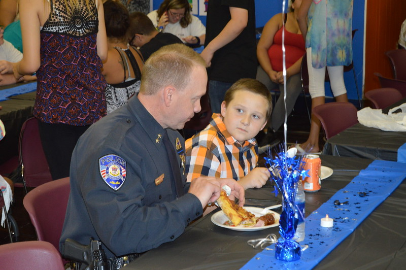 Chief Tyson Kerr enjoys the meal at the law enforcement appreciation event.
