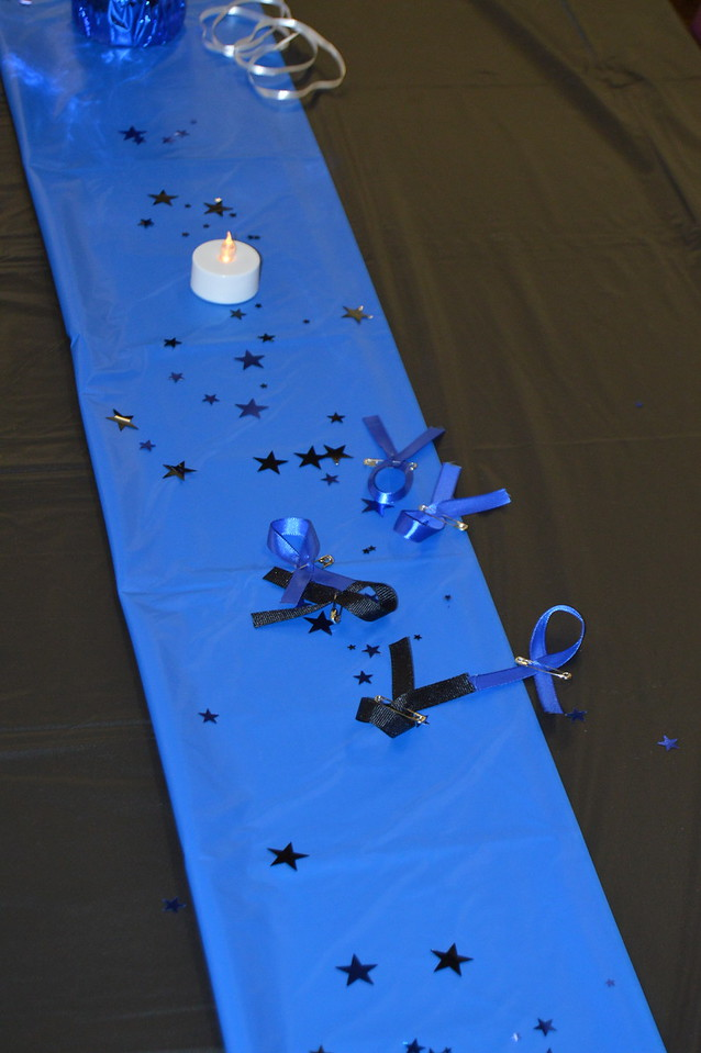 "A ""thin blue line"" running down the center of each table was decorated wih candles, stars, and ribbon pins that guests could wear home."