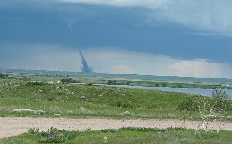"Mack Hitch photo of tornado near Peetz, seen from North Sterling State Park.  ""It had been a beautiful day.  The park was full with campers.  Completely calm, for a change.  A Sidney (Neb.) radio station talked about funnels in their area but I don't think this was one of them.  Difficult to tell from atop the rock I was on at North Sterling, but it seemed to be in extreme northern Logan County.  Life at the park went on as usual."""