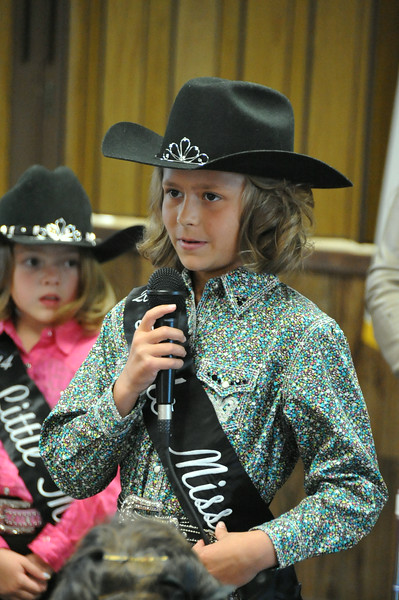 Emma Breidenbach, one of 10 Little Miss participants in the 2014 royalty program, introduces herself at the Superintendents Barbecue Thursday, July 31, 2014, at the Gary DeSoto Building.