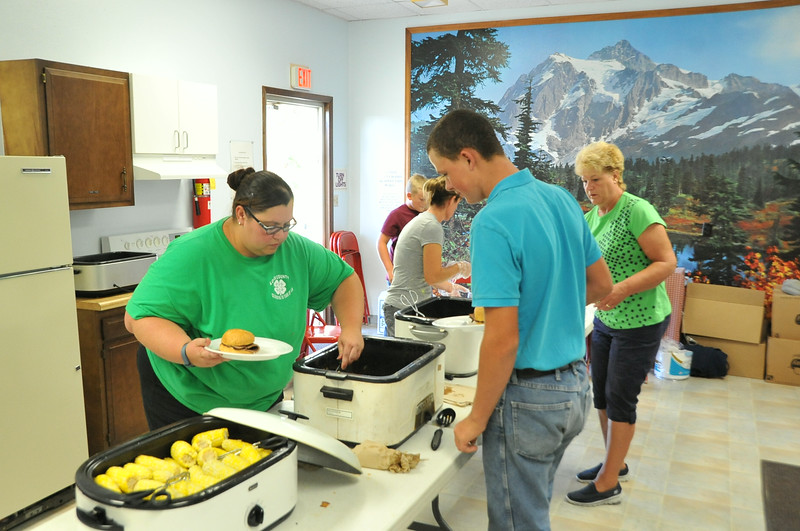 Logan County 4-H members and leaders served a meal that included roast beef sandwiches, beans and corn on the cob for the Superintendents Barbecue Thursday, July 31, 2014, at the Gary DeSoto Building.