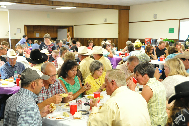 Logan County Fair personnel enjoy a meal served by the 4-H Foundation during the Superintendents Barbecue Thursday, July 31, 2014, to mark the official beginning of the 2014 Logan County Fair and Rodeo.
