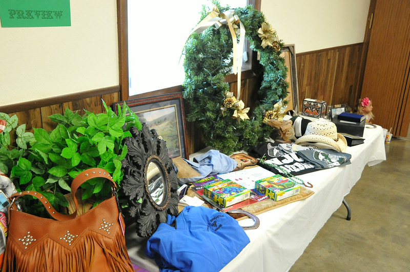 Items up for auction tonight at the Cowboy Ball to support the Miss Rodeo Logan County program were on display at the Superintendents Barbecue Thursday night, July 31, 2014, at the Gary DeSoto Building. The Cowboy Ball starts at 8 p.m. in the Exhibit Center at the Logan County Fairgrounds; the Austin Wahlert band will be playing.