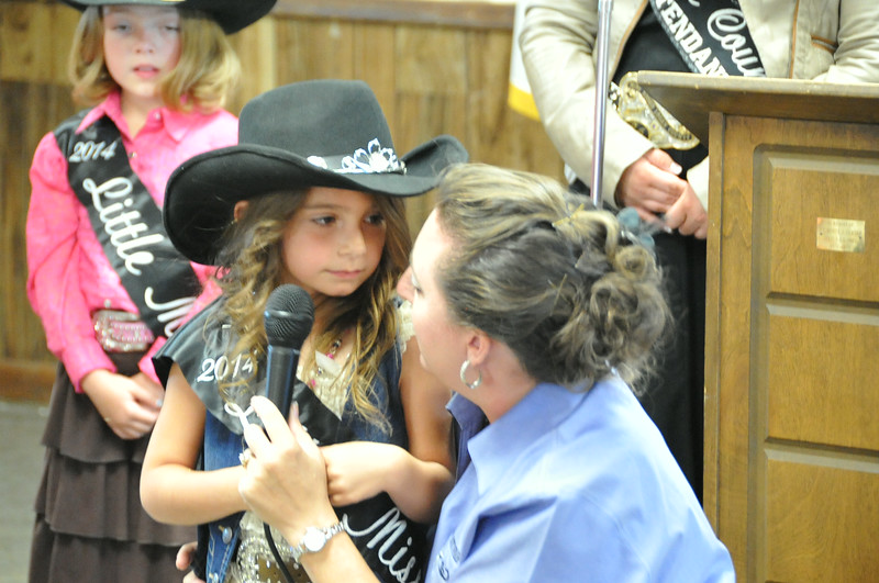2014 Little Miss Alexis Gentry practices her introduction at the Superintendents Barbecue.