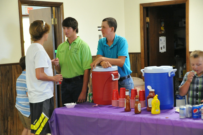 4-H youth help serve the meal at the Spuerintendents Barbecue Thursday, July 31, 2014, at the Gary DeSoto Youth Center.