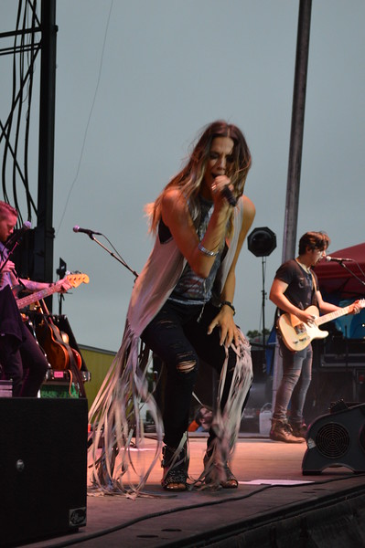 """JaJana Kramer sings """"Why you wanna"""" during her opening act of the night show at the Logan County Fairgrounds on Saturday."""