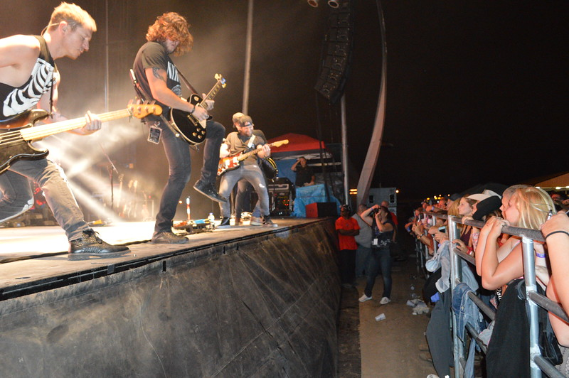 Canaan Smith and his band jam for the fans during the Logan County Fair night show Saturday, Aug. 6.