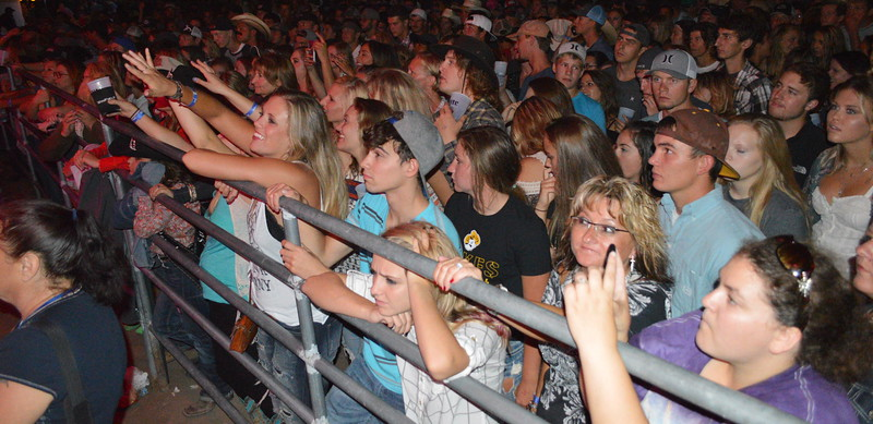 The crowd interacts with A Thousand Horses during the night show at the Logan County Fairgrounds Saturday.