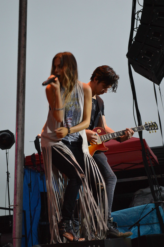 Jana Kramer and her lead guitarist kick off the night show at the Logan County Fairgrounds on Saturday.
