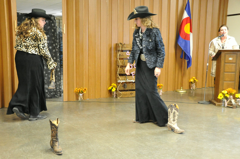 "Regan Wheeler and Bobbi Jo Lingreen (left) set up for the ""Boots Barrels Bonanza"" during the 2014 Logan County Royalty Contest Saturday, Aug. 2, 2014."