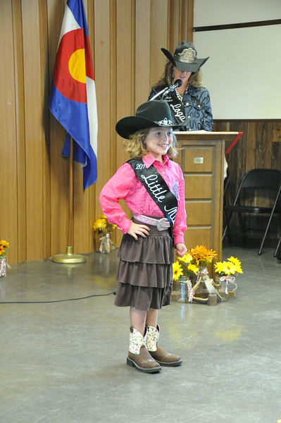 Ayla Baney, 2014 Little Miss, models during the Logan County Royalty Contest Saturday, Aug. 2, 2014. Logan County Fair
