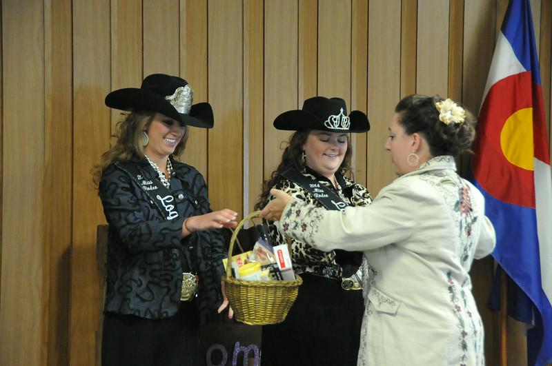 Brandee Gillham presents gifts to Miss Rodeo Logan County Regan Wheeler and MRLC Attendant Bobbi Jo Lingreen.