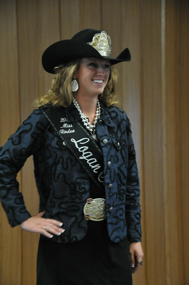 2014 Miss Rodeo Logan County Regan Wheeler models her formal outfit during the MRLC contest Saturday, Aug. 2, 2014, at the Logan County Fair.