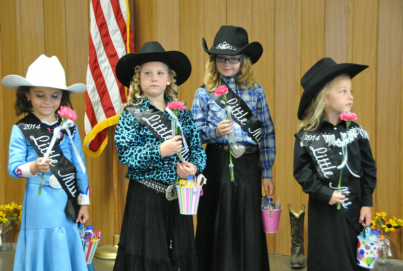 Little Misses receive gifts from the 2014 royalty during the 2014 Logan County Royalty Contest Saturday, Aug. 2, 2014.