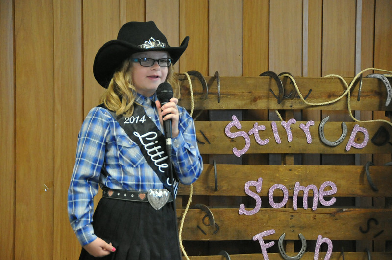2014 Little Miss Molly Mitchell gives her introduction during the 2014 Logan County Royalty Contest Saturday, Aug. 2, 2014.