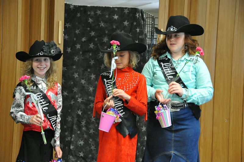 Little Miss contestants, from left, Tobi-Beth Erickson, Emma Breidenbach and Natali Boerner receive gifts from Miss Rodeo Logan County Regan Wheeler and Attendant Bobbi Jo Lingreen.