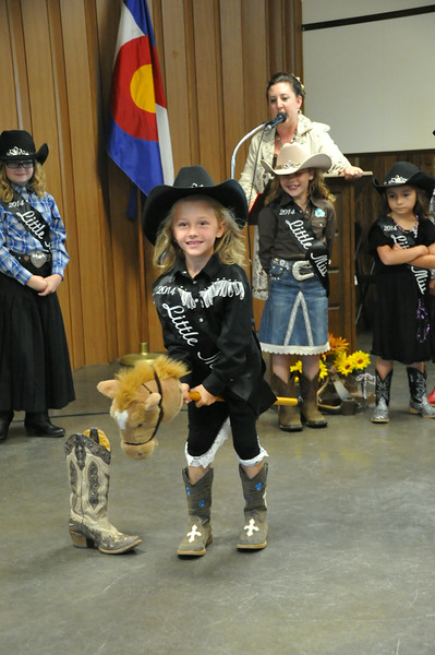 Crystal Horner rides her stick horse through the barrel race pattern for the 2014 Logan County Royalty Contest.