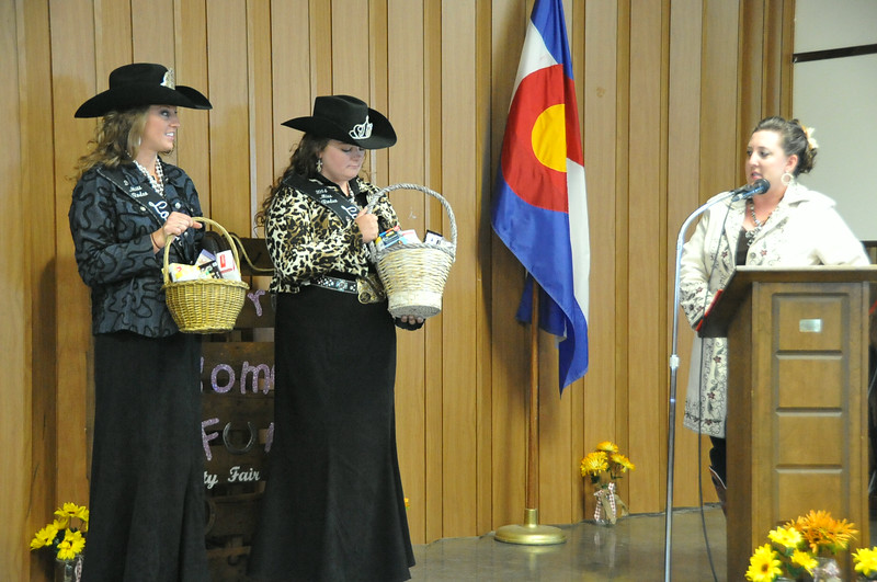 Brandee Gillham presents gifts to Miss Rodeo Logan County Regan Wheeler and MRLC Attendant Bobbi Jo Lingreen.