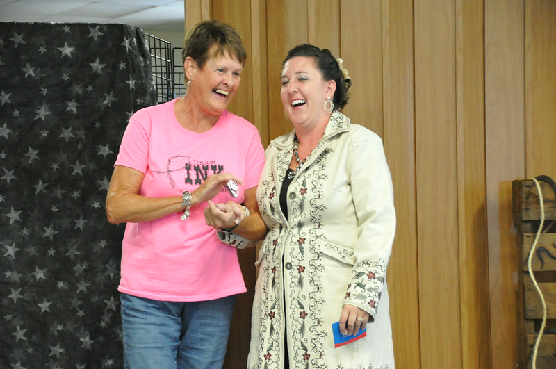 Brandee Gillham thanks Dottie Benson for her help with the Logan County Royalty Contest and MRLC program.