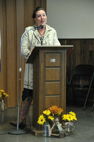 Royalty program coordinator Brandee Gillham welcomes guests to the 2014 Logan County Royalty Contest Saturday, Aug. 2, 2014.