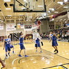 Logan Sircy soars through the air in the Peetz district semifinal game against Weldon Valley. The No. 2-seeded Bulldogs won, 68-62. (Melanie Kindvall/Courtesy photo)