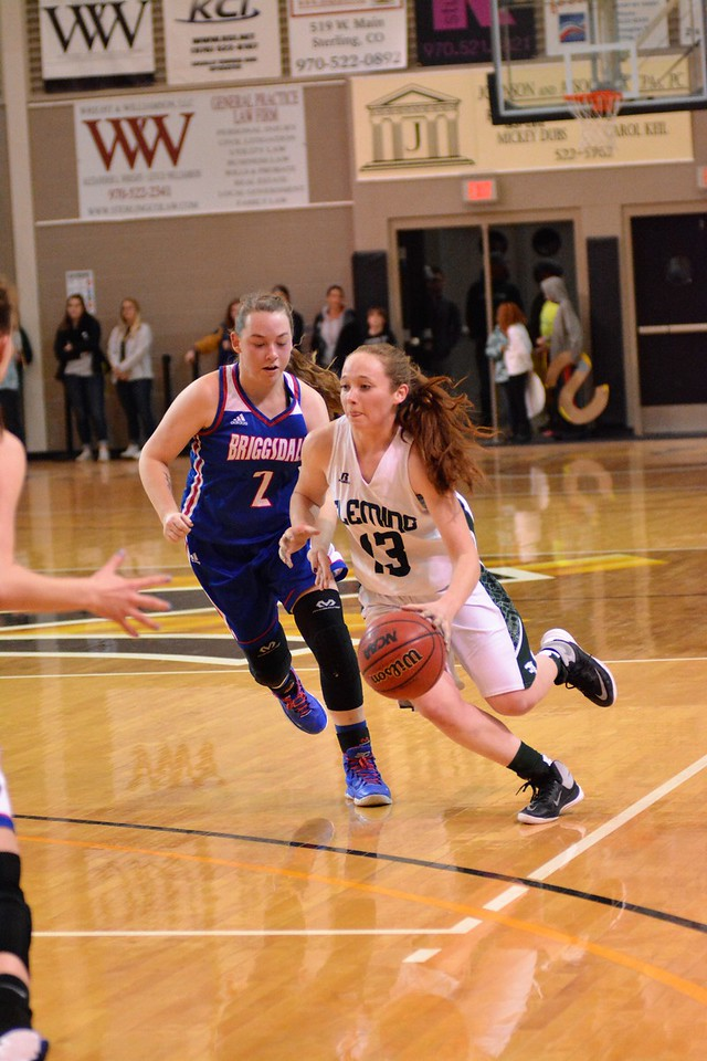 Sandra Lockard drives down the court in the Fleming girls district basketball game vs. Briggsdale. (Karianne Donnelson/Courtesy photo)