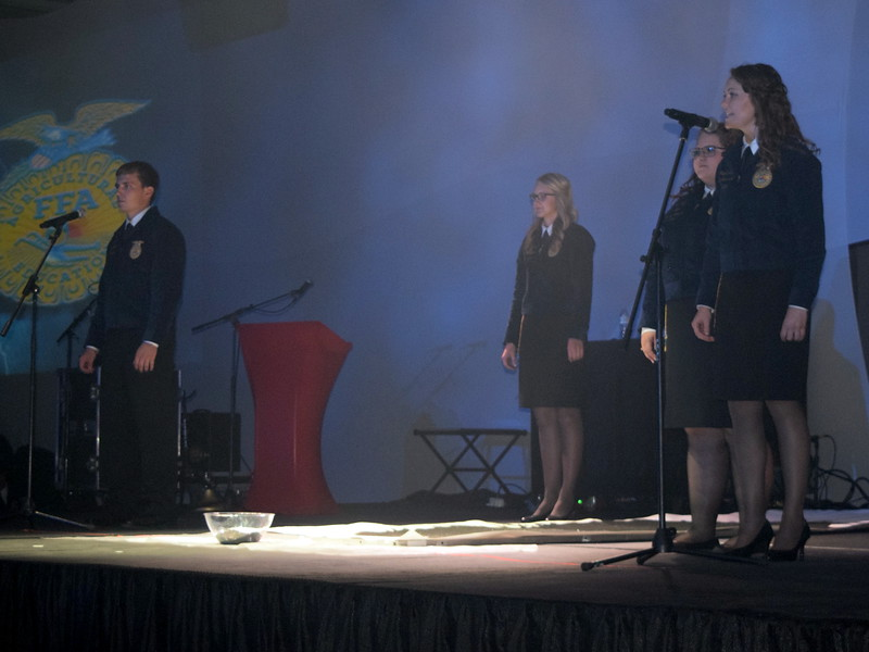 State FFA officers Nick Vollmer, sentinel; Emma Mortensen, president; Tia Rozell, executive committee; and Rachael Latta, treasurer, speak during the opening session of the 88th Annual Colorado FFA State Convention Tuesday, June 7, 2016.