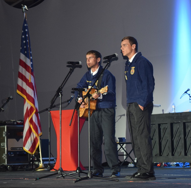 "Peyton and Braedon Kloberdanz, state FFA talent search competitors from the Sterling FFA chapter, perform ""Barbed Wire Halo"" during the opening session of the 88th Annual Colorado FFA State Convention Tuesday, June 7, 2016."
