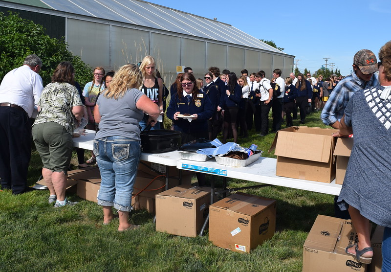 FFA members line up to get food at the opening dinner of the 88th Annual Colorado FFA State Convention Tuesday, June 7, 2016.