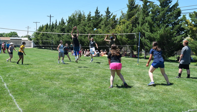 FFA members reach for the ball during a volleyball tournament to kick off the 88th Annual Colorado FFA State Convention Tuesday, June 7, 2016.