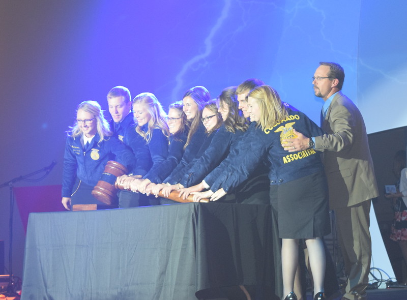 The 2015-16 State FFA Officers kick off the opening session of the 88th Annual Colorado FFA State Convention Tuesday, June 7, 2016. From left; Emma Mortensen, president (Brush); Bryce Funk, secretary (New Raymer); Megan Thormodsgard, reporter (Briggsdale); Tia Rozell, executive committee member (Soroco); Whitney Mount, executive committee member (Brush) ; Tierney Wilson, executive committee member (Cortez); Kaila Thieman, executive committee member (Fruita); Nick Vollmer, sentinel (Merino); Rachael Latta, treasurer (Cedaredge); Rayna Hodgson, vice president (Platte Valley); and state FFA adviser Kenton Ochsner.
