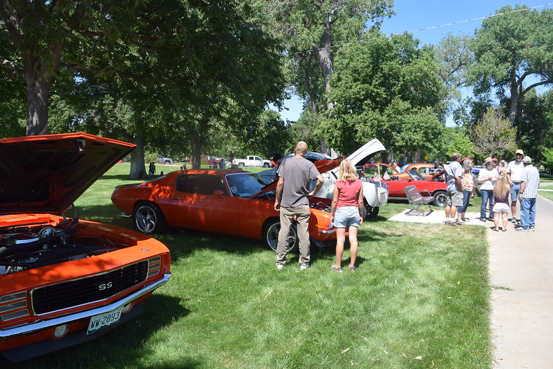 A crowd looks over vehicles on display at Colorado Flatlanders 25th Annual Rod Run in the Park Saturday, July 9, 2016, at Pioneer Park.