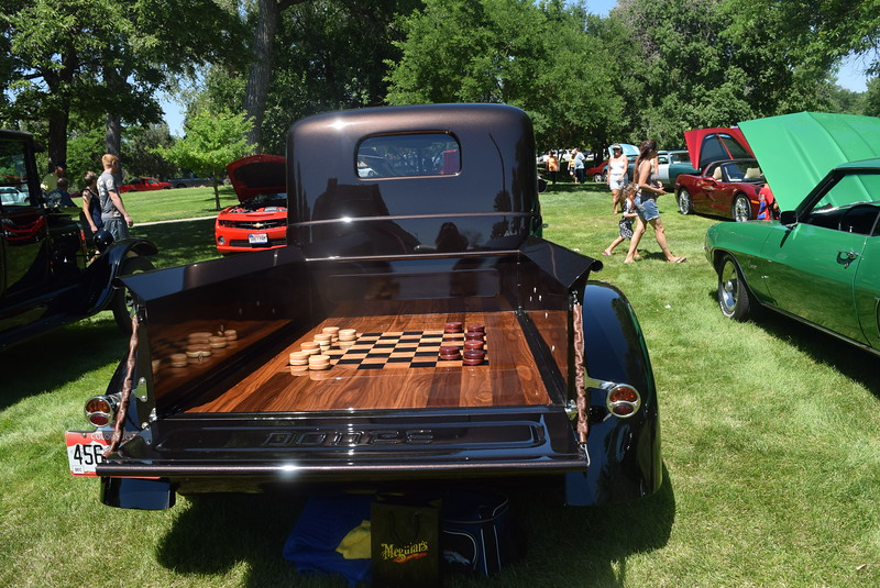 The back of a 1947 Dodge WC 100, owned by Mark Winston, of Golden, is setup for a game of checkers. The pickup was among a variety vehicles on display at Colorado Flatlanders 25th Annual Rod Run in the Park Saturday, July 9, 2016, at Pioneer Park.