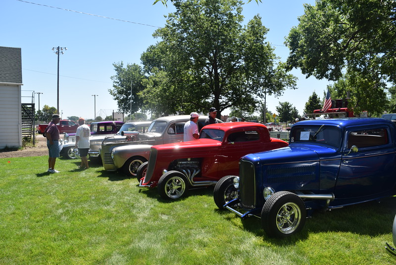 Guests look some of the many vehicles on display at Colorado Flatlanders 25th Annual Rod Run in the Park Saturday, July 9, 2016, at Pioneer Park.