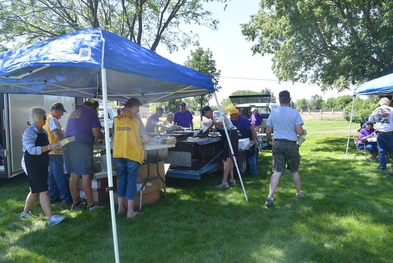 Sterling Lions Club members were busy grilling up hamburgers on their mega grill for guests at Colorado Flatlanders 25th Annual Rod Run in the Park Saturday, July 9, 2016, at Pioneer Park.